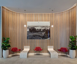 Precise illumination of the lobby features at 40 Miller Street, including grazing timber panelling on curved walls with Aduro CL.