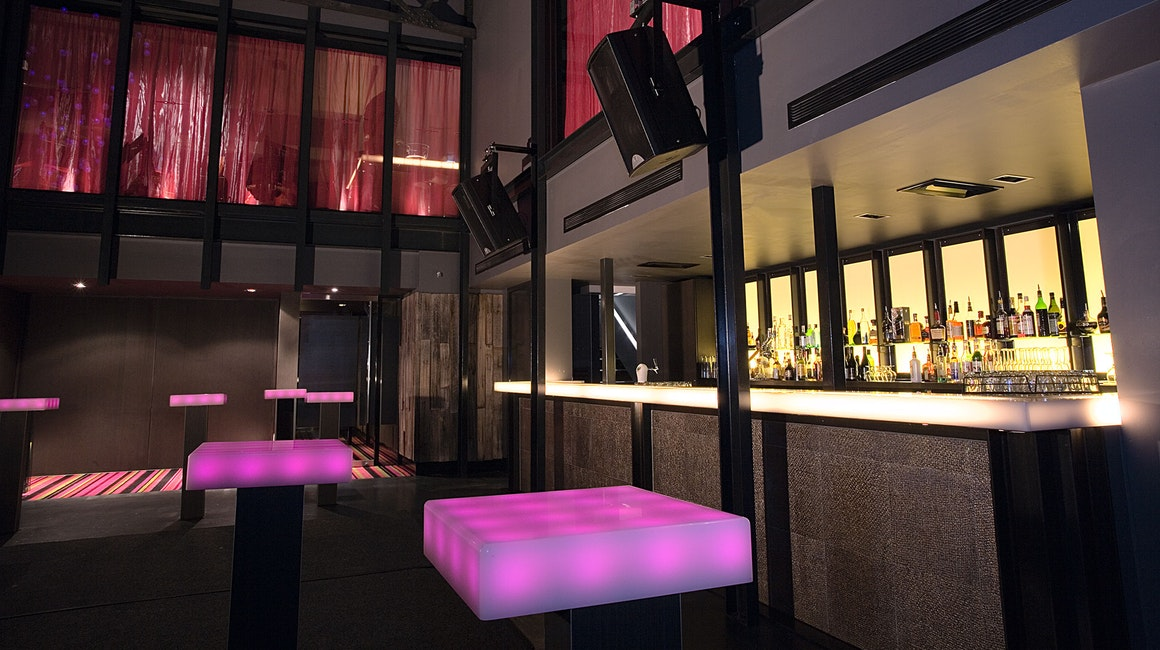 ELS Downlights were used to up-light the Buddha feature wall in the main room, casting coloured shadows over the bronze crevices. Square and round DMX panels were used in the bar tables.