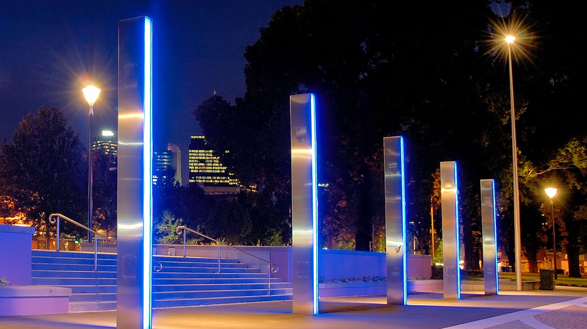 The installation provides striking blue light and glowing ambient lighting which attracts many visitors to the park's fresh and modern atmosphere.