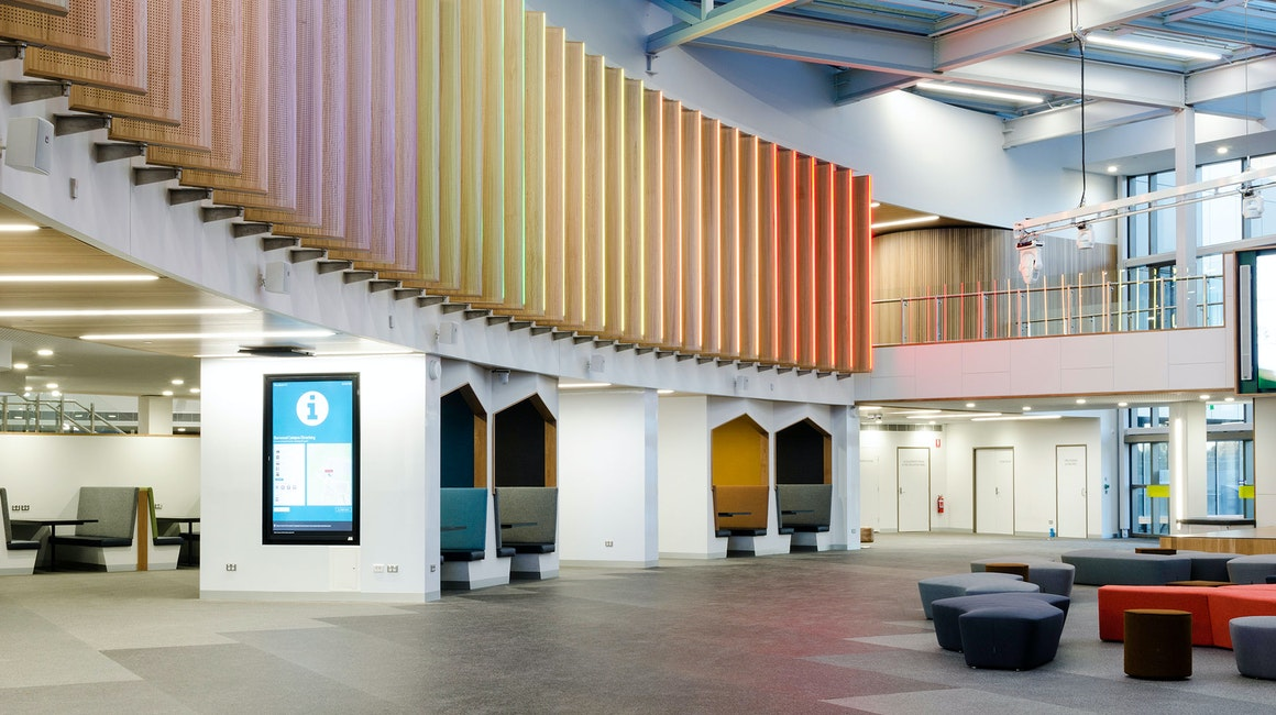 Spectrum RGB strip illuminates the feature panelling adorning the Central Precinct hub.