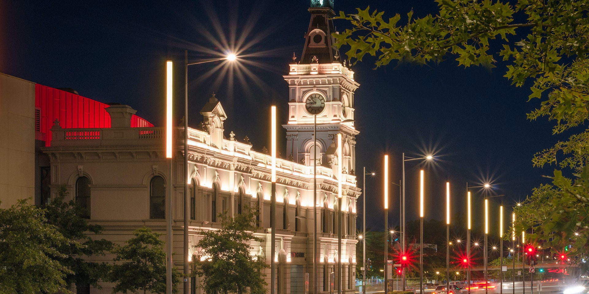 Latitude LED luminaire in application, installed on the façade of the former Dandenong Town Hall, now known as the Drum Theatre in Melbourne. Night view.