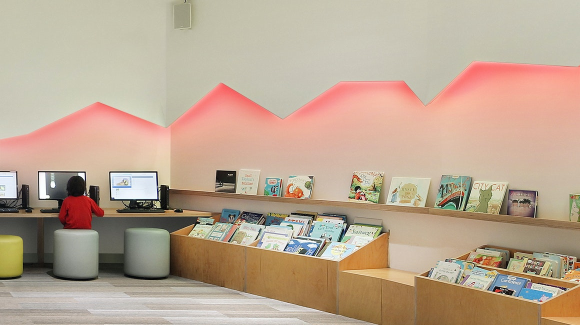 The colour changing Spectrum RGB strip illuminates a feature wall, creating an appealing and whimsical space.