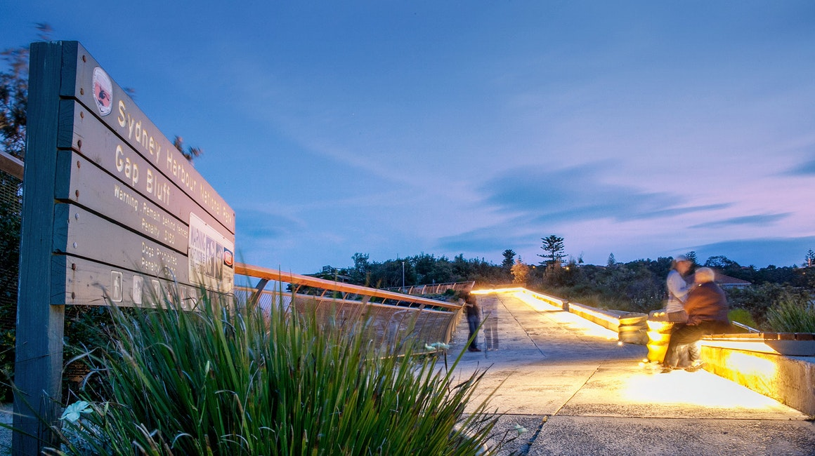 Gap Park in Watsons Bay, NSW features an installation of side-emitting strip lighting to create a continuous warm white glow under the bench seating.
