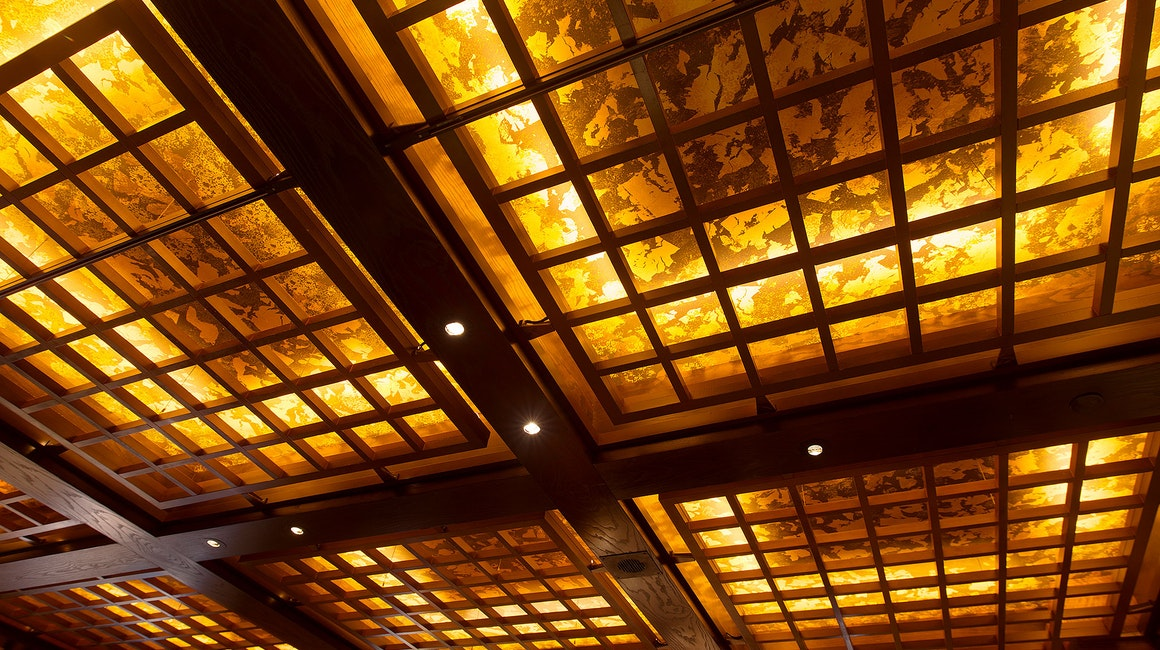 Strip lighting is featured in Koko's feature ceiling. The installation provides CCT dimming, which simulates the behaviour of an incandescent light source by becoming warmer as it dims.