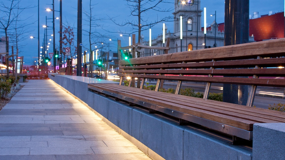 An installation of 68 illuminated colour changing poles lines the Lonsdale Street shopping precinct in Dandenong, Melbourne