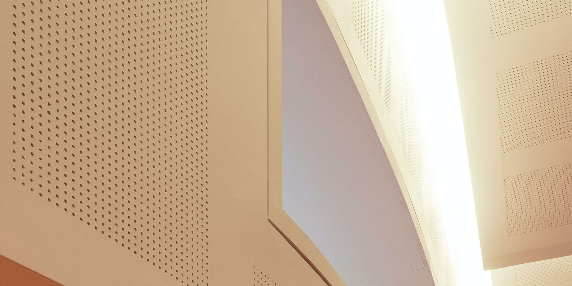 Primo X2 LED strip in application, installed in the Swinburne University AMC Building Lecture Theatre. Multiple soffits create a wave-like effect and double as an indirect lighting source.