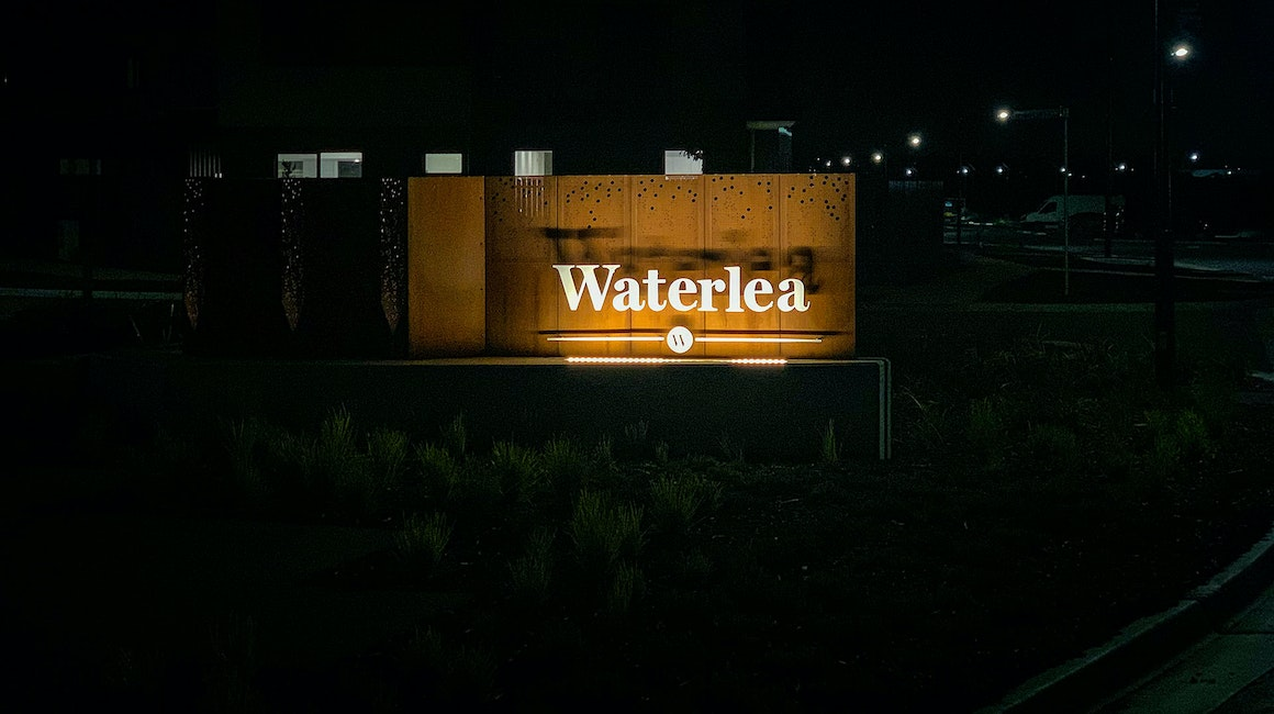 Mounted inside a compact rebate, Max Mini IP gently grazes the Waterlea Village entrace signage.