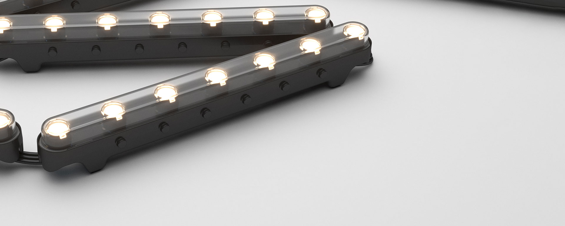 Aduro CL is a modular chain LED fitting that has a flexible connection between each segment, enabling use along curved surfaces to create wall washing and grazing effects, while retaining efficacy and durability of rigid technology.