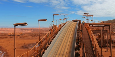 Conveyor belt on an iron ore is illuminated by a range of Coolon fittings.