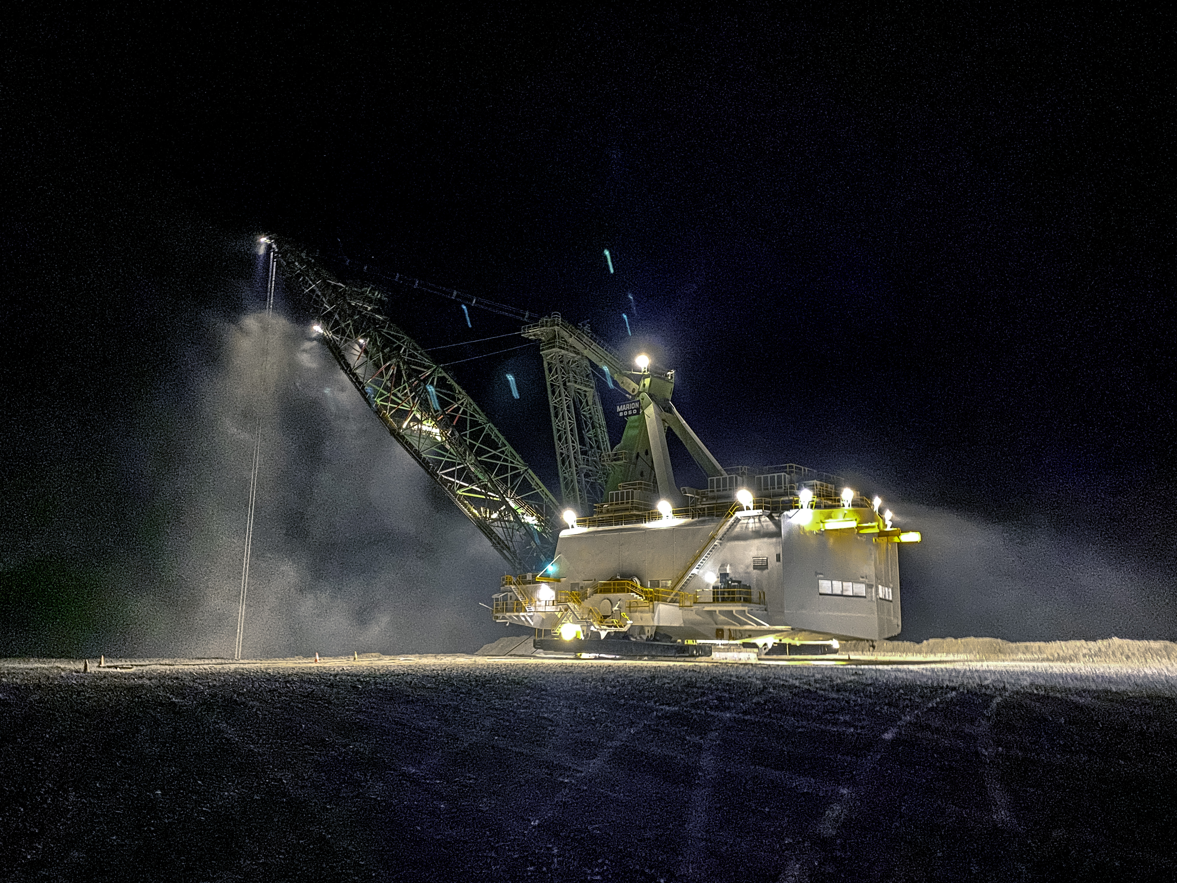 Marion 8050 dragline working at night, lit up with Coolon XBlades.