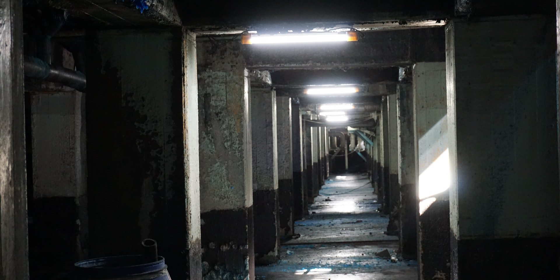 AC2 Mining Lead Light in application, installed in an underground mine long dark corridor
