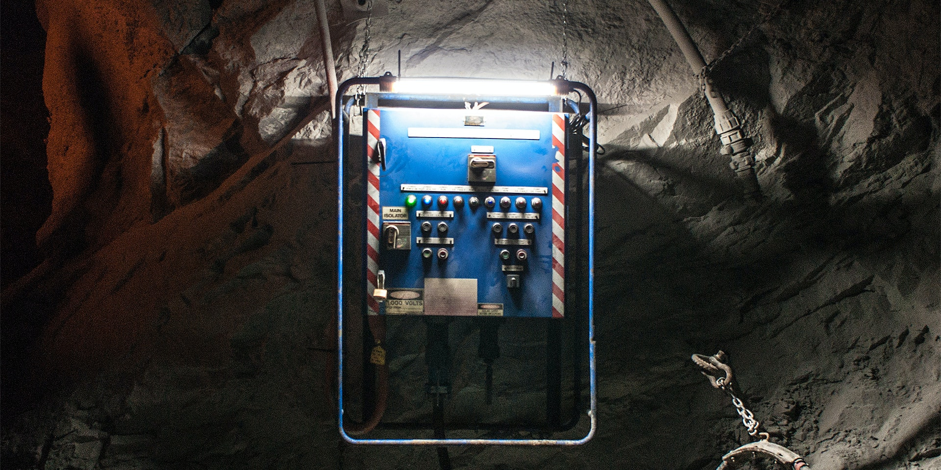 AC2 Mining Lead Light in application, installed in an underground mine over a switch board