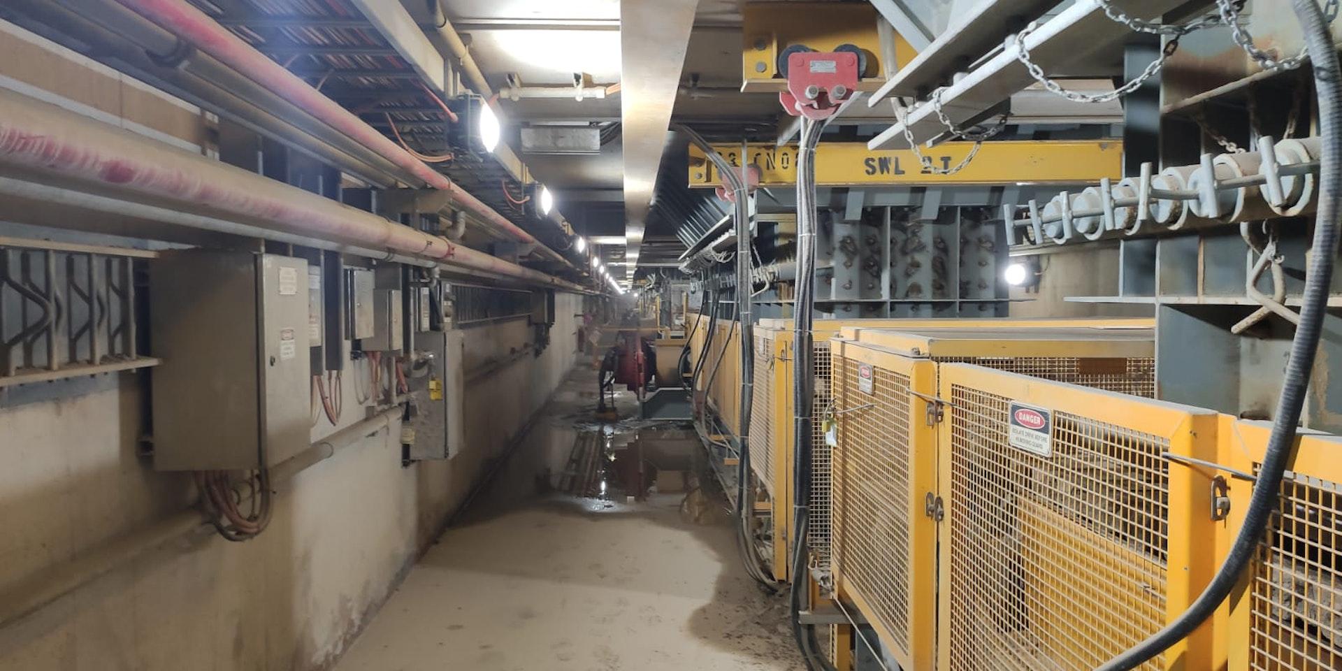 Emergency Bulkhead / Bulkhead LED light in application, installed in an industrial / mining conveyor tunnel