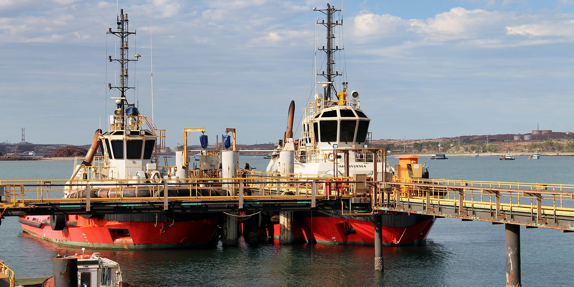 CP56 LED Flood Light in application, installed ob tug boats in a bulk port on iron ore