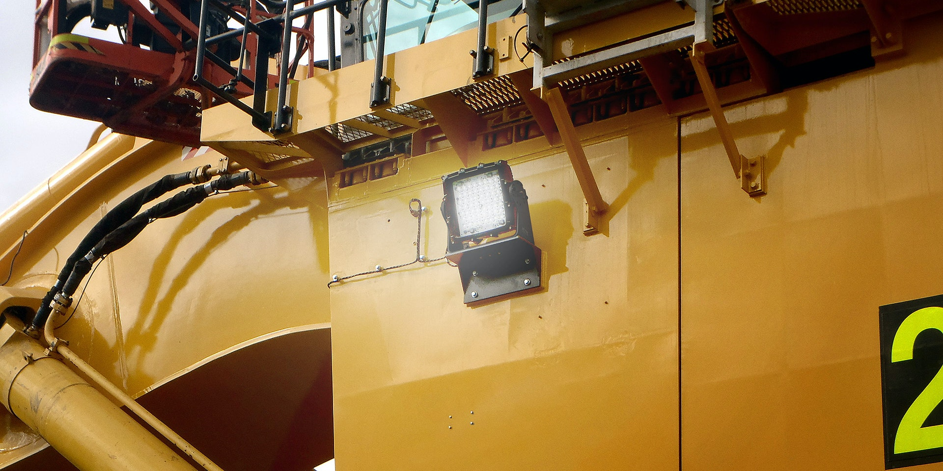 CP56 LED Flood Light in application, installed on a large hydraulic excavator komatsu on an industrial / mine site