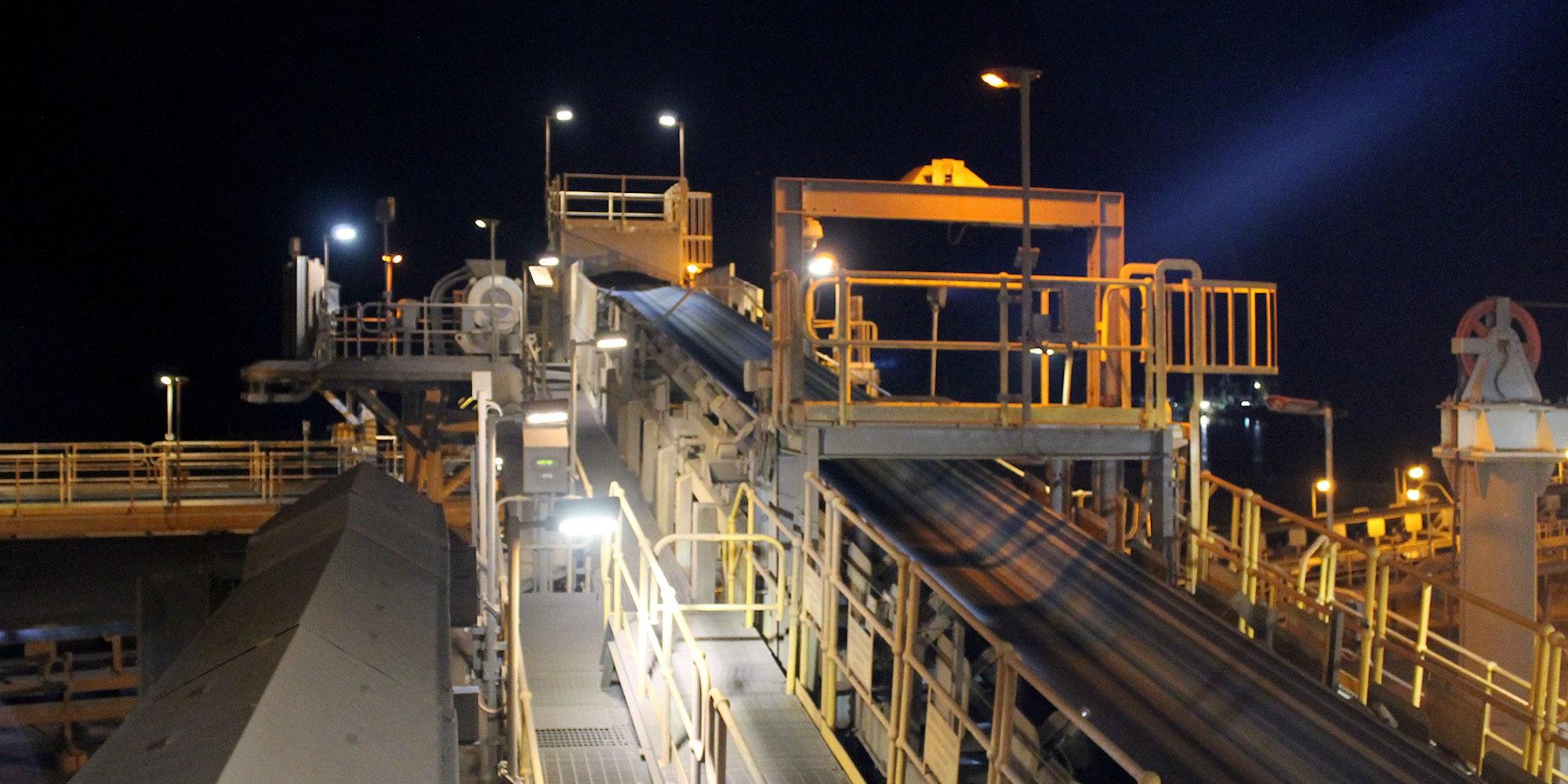 DLK2 LED Conveyor / Area Light in application, installed on a conveyor belt junction in a bulk port