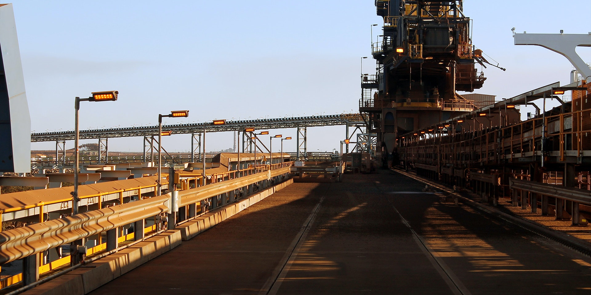DLK LED Conveyor / Area Light in application, installed on a conveyor on an iron ore mine in bulk port