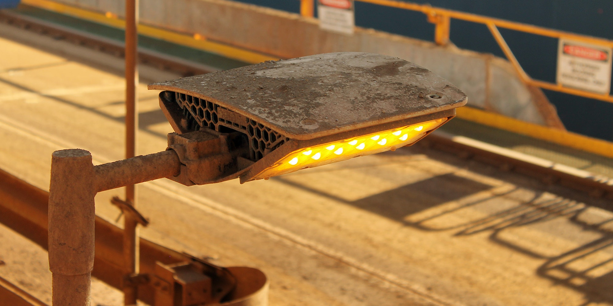 DLK LED Conveyor / Area Light in application, installed on a conveyor on an iron ore mine in bulk port, close up photo