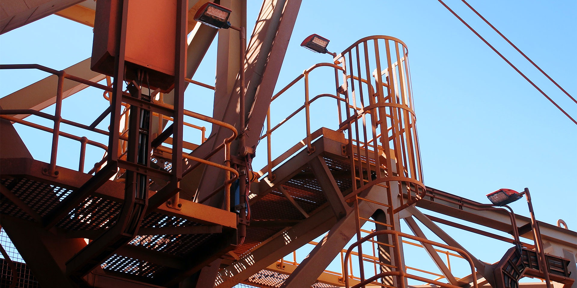 DLK LED Conveyor / Area Light in application, installed on a stacker reclaimer,  on stairwells and platforms