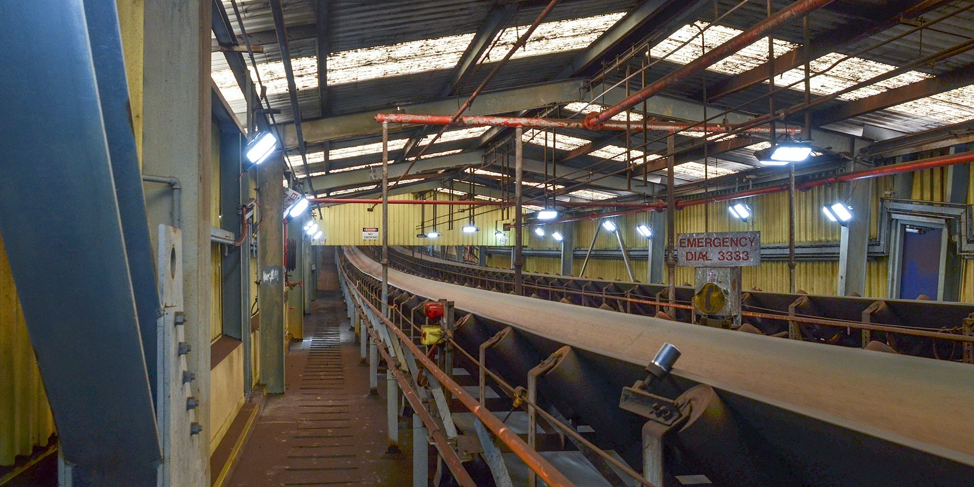 Tunnel Ray LED Tunnel / Low Profile Light in application, installed on an enclosed rising conveyor on a  coal fired power station